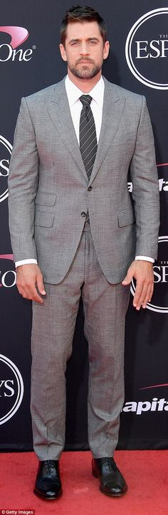 Green Bay Packer and ex of Olivia Munn Aaron Rodgers was well-dressed in a gray plaid suit paired with sharp diagonally striped tie and handsome scruff upon his glass-cutting jaw