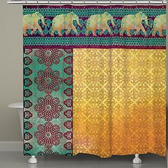 Add some boho flair to your bathroom with the Marrakesh Shower Curtain from Laural Home. Featuring a parade of elephants on top of Moroccan patterns and bright colors, this 100% polyester shower curtain will enliven any bathroom in your home.
