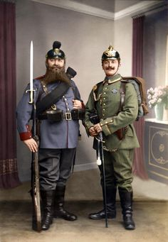 German soldiers pose with their new uniforms. The soldier on the left looks like he's Bavarian, going by the blue colour of his uniform. WW1 colourized photo.
