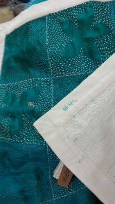 The Stitching Project 1.7.14- Quilt # 41. Aqua Flowers Quilt. Handloom khadi cotton by Gaffer, re-cycled silk saris , Hand stitch by Mrs Om, Laxmi, Hem, Raj, Machine by Shaquil