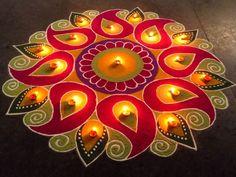 Beautiful Happy Diwali Rangoli easy and simple ideas Check some easy decorations of Deepawali Rangoli with symbols like Swastik & Ganesha,