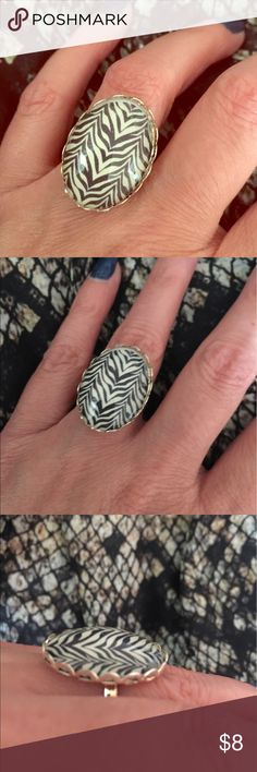 Zebra Print Cameo Silver Ring Punk Retro Ska NWT Brand new, never worn, zebra print cameo ring. Ring is missing card, was tried on, but never worn. It is on a silver base, with an adjustable band. Cameo is made of glass. Can fit any size. Hot Topic Jewelry Rings