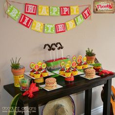 Cute ideas! Like the sombrero and guitar and the bowls turned upside down to support cupcake plates