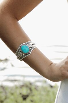 Beautiful Turquoise silvered white metal cuff bracelet, handmade in Nepal. Beautiful side detail with open back that squeezes onto the wrist. Fits all, best wor