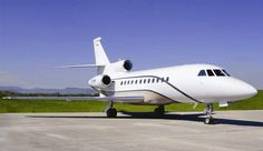 The Dassault Falcon 900 (900B/900DX/900EX) charter jet is a three-engine corporate heavy jet that has a flight range of 3,800 nm, the longest in its class of business jets and a high operating altitude of 51,000 feet.  The Falcon 900's full galley can house everything the discerning luxury traveler requires for multiple full course meals while in flight.  To charter a private jet or other aircraft, call one of our helpful associates at (888) 594-7141.