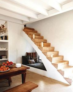 Cozying up in this hidden nook under the staircase.
