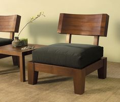 An awesome set of wood zen style chairs, with a unique table featuring a dip that holds decorative rocks.