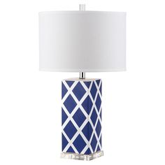 Showcasing a diamond trellis motif and a crisp white drum shade, this chic table lamp is the perfect addition to your reading nook or nightstand.