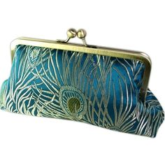 Peacock Clutch Purse in Teal and Gold Silk Brocade Antique Brass Frame and other apparel, accessories and trends. Browse and shop 8 related looks.