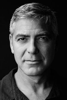 George Clooney (1961) - American actor, film director, producer, and screenwriter. Photo © Jeff Vespa