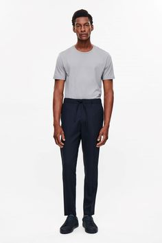 COS image 1 of Drawstring tailored trousers in Navy