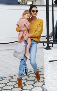 Casual style: Model Lily Aldridge carried her three-year-old daughter Dixie Pearl as they left Au Fudge restaurant in Los Angeles on Tuesday