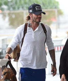 He's got style: David Beckham opted for a casual look when he touched down at JFK airport in New York City on Friday... as his son Brooklyn was spotted at the site of the horrific Grenfell Tower fire