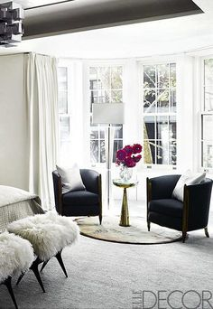 Sleek Black Club Chairs And A Sculptural Side Table In Gold Make Dramatically Modern Seating