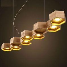 suspension bois design par Pilke Light en forme nid d'abeilles à 9 alvéoles hexagonales