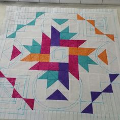 Marking a quilt for quilting. What fun!