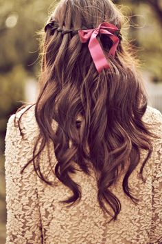 simple hair inspiration: loose braid half up and down ponytail with '60s kitten ribbon bow