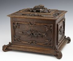 Continental Carved Humidor, The Stepped Lid With A Large Relief Grape Bunch And Leaves, Lifting To Reveal An Interior With Six Sliding Trays, Each Holding 12 Cigars, On A Stepped Base With Scrolled Feet   c.19th Century