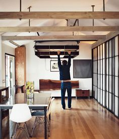 """""""The Tiny Hollywood Home of Mad Men's Vincent Kartheiser"""" in Dwell magazine's November 2013 issue. In the article's accompanying slideshow, it is this picture of Kartheiser pulling his bed down from the ceiling that took my breath away..."""