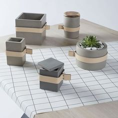 Concrete and leather pots, vases and bowls