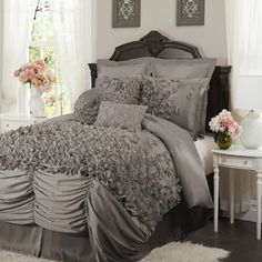 Ruffled comforter set with hand-sewn detailing in gray.   Product: One comforter, one bed skirt and two pillow shamsC...