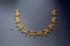 mycenae - eagle necklace Shaft Grave V, Grave Circle A, Mycenae. 1600-1500 BC. National Archaeological Museum, Athens. Gold necklace consisting of ten foils, each shaped in a pair of antithetic eagles - a symbol of power.