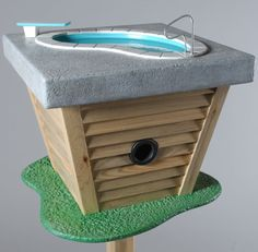A birdhouse with a pool for a birdbath.  So cute and funny!  Where's the clubhouse feeder? ha  via Web Ecoist