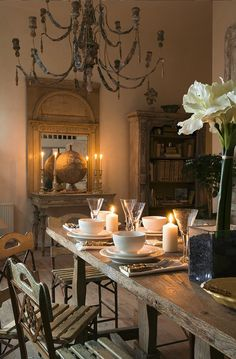 Dinner among the French country antiques. love tables, cabinet mirror, and of course the chandelier!!!