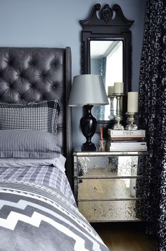 A stunning and bold gray and black bedroom. A simple color palate done well - take a look at Simone's home tour for gray and black decor inspiration.