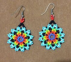 Beautiful earrings huichol Yoguish by CoolturaMexicana on Etsy - Bracelets Tutorials Bead Jewellery, Seed Bead Jewelry, Seed Bead Earrings, Flower Earrings, Beaded Earrings, Beaded Jewelry, Hoop Earrings, Beaded Flowers Patterns, Beading Patterns