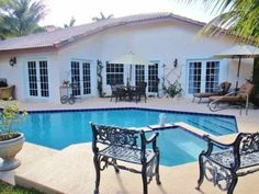 Wonderful Outdoor Deck Area - 4 bedroom private pool home with tiki bar