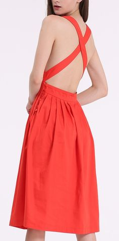 This orange sleeveless backless dress is so me!