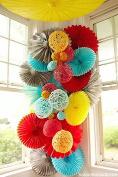 Great Color scheme for an elementary classroom - Fun, bright colors but can be muted when needed. How they are hanging but instead of those thick twine balls we can use our tissue paper pom poms Festa Party, Party Party, Paper Crafts, Diy Crafts, Decor Crafts, Diy Paper, Yarn Ball, Diy Décoration, Paper Decorations