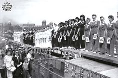 CCT0057 - Miss War Worker Pageant 1942 at the CNE Grandstand. Contestants are grouped by employer. Toronto, Ontario July 18, 1942.