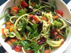 ZOODLES (Zucchini noodles): zucchini noodles or 'zoodles,' as some affectionately call them? They're a great way to get your pasta fix if you're gluten-free or grain-free. This is a super simple recipe to make. All you have to do is throw everything in the pan, sauté until soft, and top with lemon juice, olive oil, parsley, and olives.