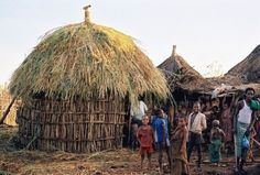 Somali Bantu live in huts.  They are building a new hut in the village of Banta.