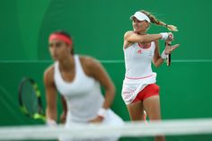 Kristina Mladenovic Photos - Caroline Garcia and Kristina Mladenovic of France in their doubles match against Misaki Doi and Eri Hozumi of Japan on Day 1 of the Rio 2016 Olympic Games at the Olympic Tennis Centre on August 6, 2016 in Rio de Janeiro, Brazil. - Tennis - Olympics: Day 1