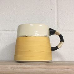 A personal favorite from my Etsy shop https://www.etsy.com/listing/549210025/yellow-mug-black-white-stripy-handle