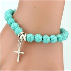 Cross Charm Vintage Turquoise Beaded Bracelet Beautiful beaded bracelet that has elastic stretch for any size wrists. Beads are green with Cross charm dangling Jewelry Bracelets