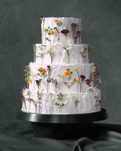 6 Fresh Ways to Decorate Wedding Cakes With Flowers | Martha Stewart Weddings - Edible flowers, from $9.50, http://gourmetsweetbotanicals.com #GrowYourOwnWedding