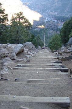 The Manitou Springs Incline, also known as the Manitou Incline or simply the Incline, is a popular hiking trail rising above Manitou Springs, Colorado, near Colorado Springs. The trail is the remains of a former incline railway whose tracks washed out during a rock slide in 1990. The Incline is famous for its sweeping views and steep grade, as steep as 68% in places, making it a fitness challenge. The incline gains over 2,000 ft of elevation in less than one mile.
