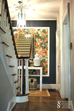 BM Hale Navy accent wall with framed wallpaper - or could use fabric
