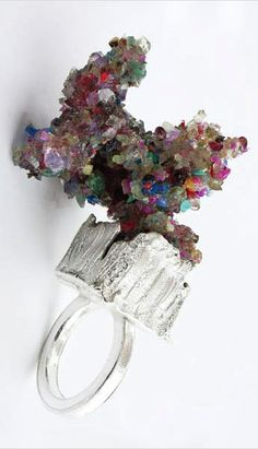 Kelvin J Birk Artist (Gold and Silversmith) ring \sapphires rubies emeralds and other precious stones are smashed and then reconstructed on precious metal structures...\ narrative from website  image from