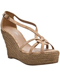 Cork strap espadrille wedge in natural from Oscar de la Renta. This espadrille features an open toe, strappy cork upper, with closed back heel, an adjustable buckle ankle strap, and braided rope wedge. Platform measures 1.5
