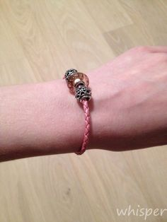 Pandora pink leather bracelet with pink fizzle murano glass.