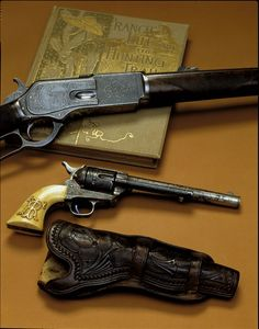 Theodore Roosevelt Colt & Winchester.