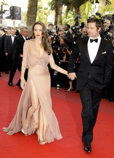Best: Angelina Jolie looks stunning in a nude Versace gown slit to the waist as she supports Brad Pitt at the Cannes Film Festival's premiere of Inglourious Basterds in 2009.
