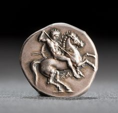 Silver stater, Tarentum (315-302 BC) - nude rider on galloping horse to right, spear held in right hand and two spears and shield in left hand - market