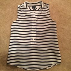 Jcrew navy blue and white striped tank top Silky tank top with navy blue and white stripes. Button up half way to top J. Crew Tops Tank Tops