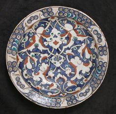 The split‑leaf palmette motifs found on this dish became a pervasive design element within the imperial Ottoman workshop. Most likely inspired by Persian manuscript illumination, Ottoman artists creatively adapted this motif for their works in other media, such as ceramics and metalwork